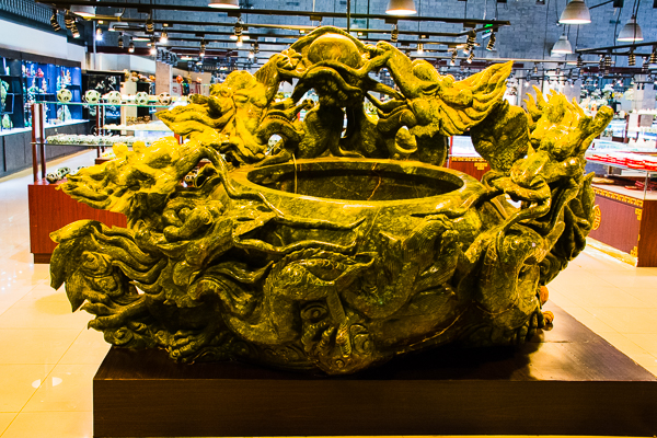 A large fish bowl covered with Jade at the Jade Factory.