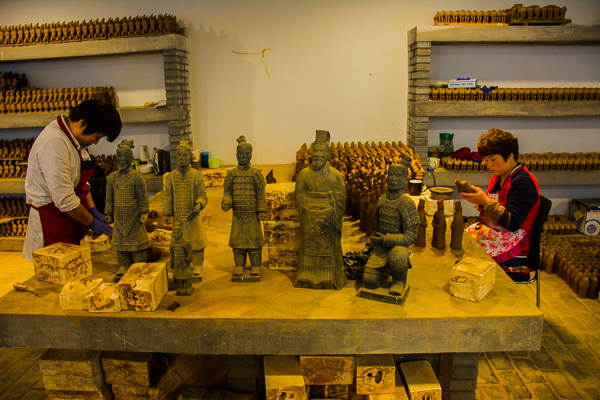 Making miniture Terracotta Warriors at the Xian Art Ceramics and Lacquer Exhibition Center.