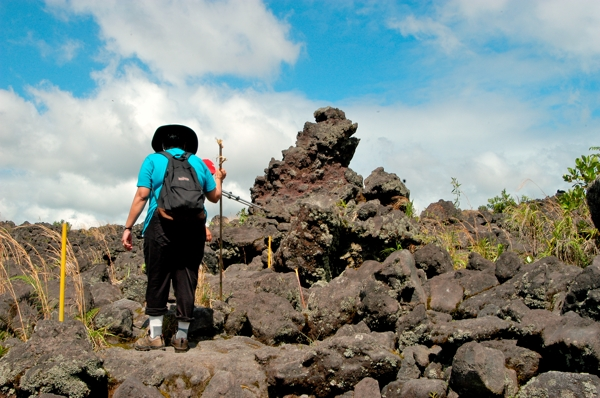 Inspecting lava at Arenal Volcano.
