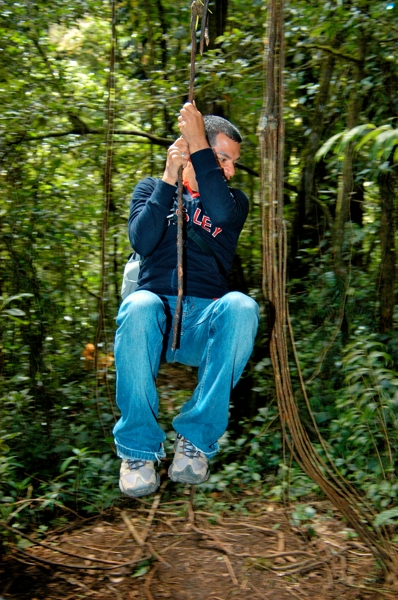 Nature guide Jimmy swinging from a vine at Monteverde.